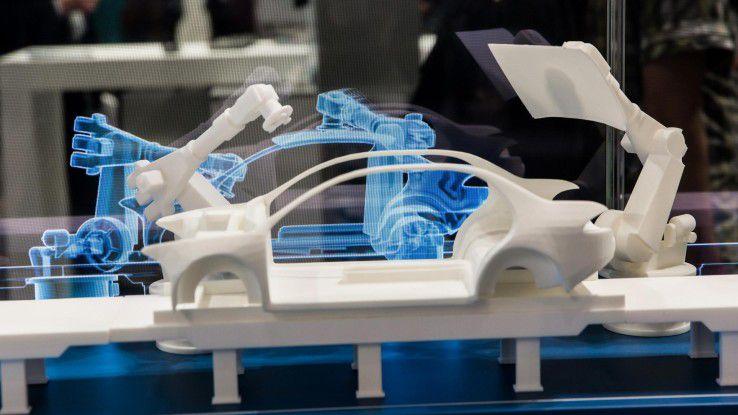 Simulation einer Autoproduktionsanlage mit Robotern und einem Digital Twin am Siemens-Stand auf der Hannover-Messe 2018