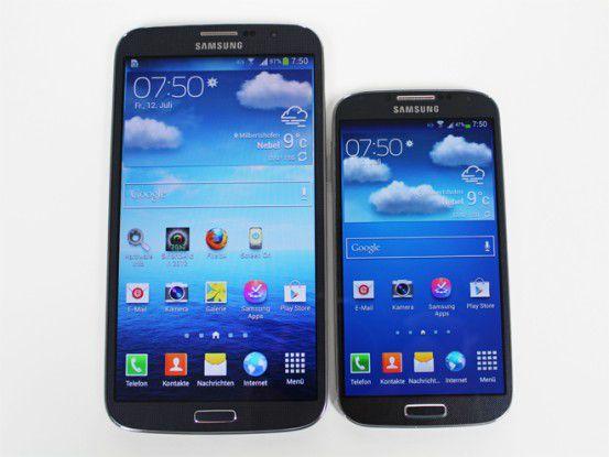Schon das Galaxy S4 (rechts) ist mit seinem 5 Zoll Display recht groß. Das Galaxy Mega (links) setzt noch eins oben drauf. Auf dem Bild ist übrigens erkennbar, dass der Super-AMOLED-Screen des S4 Farben kräftiger darstellt als der LCD des Mega.