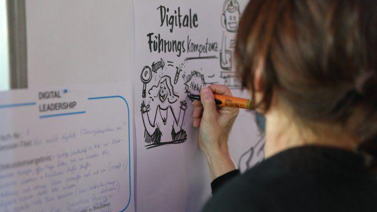 """Digitale Führungskompetenz ist ein weites Feld. Auf der Konferenz """"Digital Mind Change"""" visualisierten Experten die Ergebnisse."""